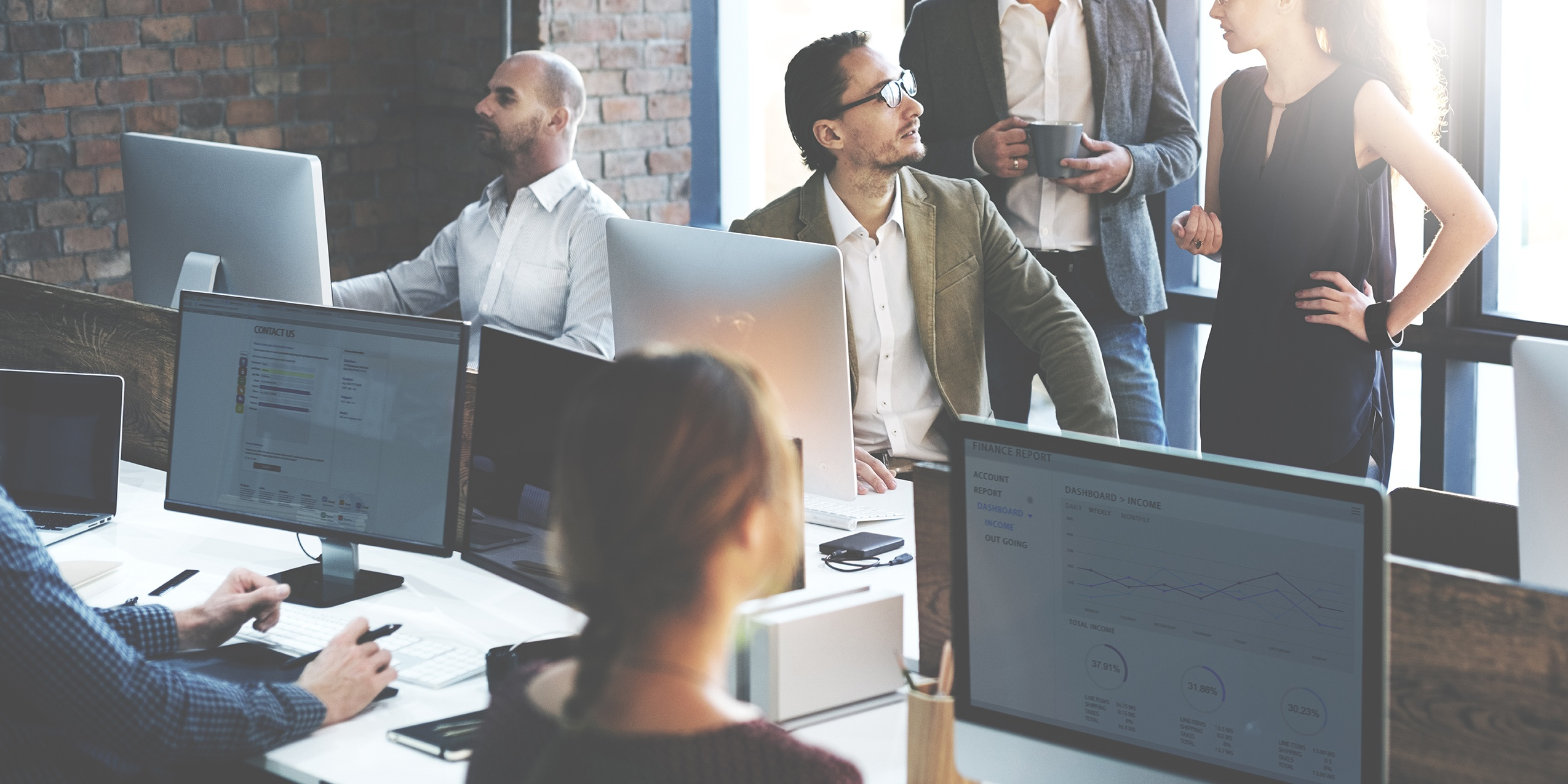 large group of people working and talking at big workstation.jpg